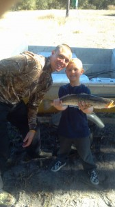 Jordan Marlo, fishing with dad Chris, caught his first trout fishing near the mouth of the river early in the month.