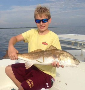 Phillip Evans, fishing with his dad Phil, nailed this beautiful redfish