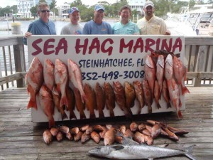 Chuck Stoerr, CW Green, Hal Wilson, and Donnie and David Sowell with a great overnight snapper trip haul