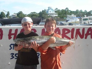 Walker Kelly needed help from Noah Plemons to hold his kingfish.