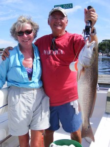 Carol and Charlie Waters with a fine upper-slot redfish.