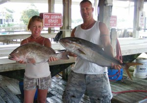 Teresa Mixon and Brad Parrish from Jacksonville with just some of their mixed offshore bag of gag and red grouper, amberjack and Florida snapper
