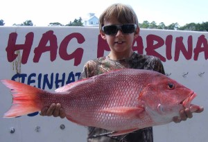 Ty Jackson from Lake City with a giant red snapper that was headed for the cleaning table.