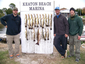 David Matthews, Hal Chambers and Jim Letourneau got these fine trout at Keaton fishing the old-fashioned way: shiner tails under corks.