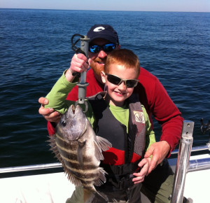 Luke Holloway with his first sheepshead and proud dad, Mark