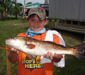 Jake Berry with an excellent redfish caught on a live shrimp.