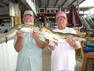 Old friends Jeff and Debbie Evans with some fine trout caught during the Optimist Club tournament.
