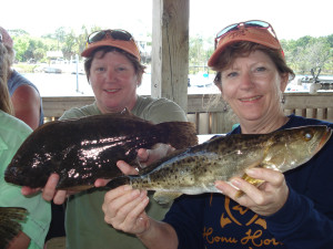 Capt. Nita Chester and twin sister Marie Griffies with a fine flounder/trout duo.