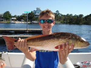 Tanner Cooper from Gainesville, fishing from a Sea Hag rental boat, caught this redfish on a live shrimp.