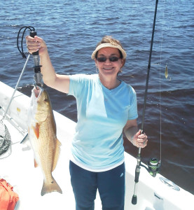 Trish Leary with a fine redfish caught on the traditional bait…..a gold spoon.