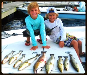 Trace and Logan with their excellent catch using live shrimp.