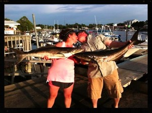 Clearly on an especially romantic fishing trip, Avi and Dorina Adler found this nice pair of cobia.