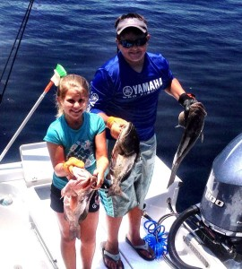 Jackson and Anna Swisher showed me some grouper before heading back out for scallops.