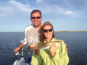 Sara and Mark with one of many trout, caught on topwater plugs