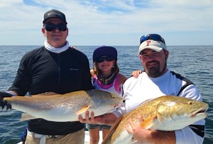 Grouper fishing is a great way to find oversize bull redfish. Jason and Ryan Norton and Cameron all hooked up at the same time.