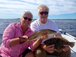 Lark Hayes from Chapel Hill, NC and Tom John from Nashville, TN with a fine redfish and flounder.