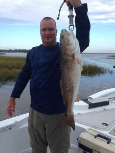 Mike Dean from Jacksonville with his fine bull redfish caught in a creek mouth.