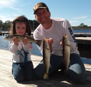 Ellie and Mark Chupp posed with some of their catch on the way to dinner.