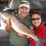 Jeff Steele and Lily Johnson from Jacksonville with one of several nice redfish they caught.