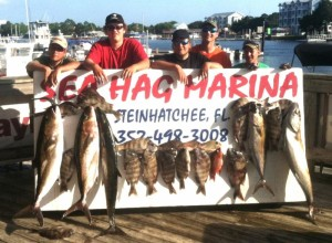 The Jarrod and Ring families with this board of amberjack and sheepshead.