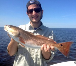 Fishing with me, Eliot Barth caught his first redfish!