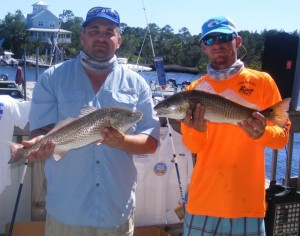 Joey Forrester and Blake O'Connor with two redfish caught in the Optimist Tournament.