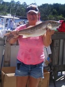Monica Kolicia caught the biggest redfish in the Optimist Tournament.