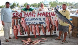 Cefus Christian and his crew with some beautiful red snapper, red grouper, scamp grouper and kingfish.