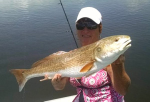 Kim Hancock with the winning redfish in the Nauti-Girls tournament.