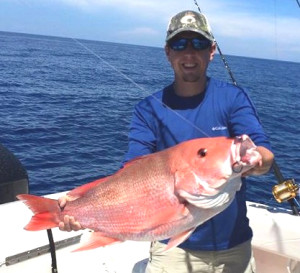 Luke Brantley with a monster red snapper.