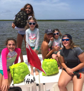The Carrington and Elliot girls with multiple limits in their Sea Hag rental boat.