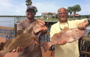 Jason Vinson and Terry Alexander with a pair of fine red grouper.
