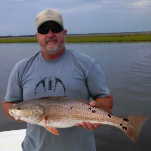 Keith Cooper and a fine redfish with lotsa spots.