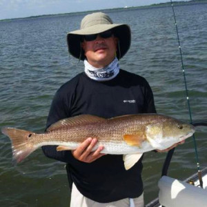 Rusty Ewing with a nice slot redfish.