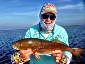 Capt. Tommy Thompson with one of five redfish we caught on an early morning trip.