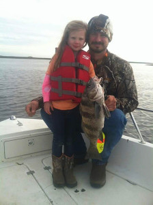 Kennedy Clark got this nice sheepshead with a little help from her dad.