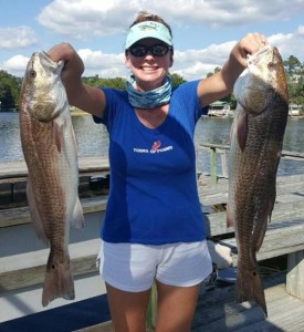 Kristin Griffis with a pair of tournament-sized redfish.