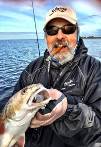 Fishing with Doug Barrett, I had to celebrate a nice redfish with a high quality cigar.
