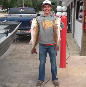Brett Molzen with a nice pair of redfish; he had to release one to stay within his limit.