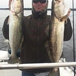 Jason Witherspoon with a pair of beautiful trout taken in deeper water.