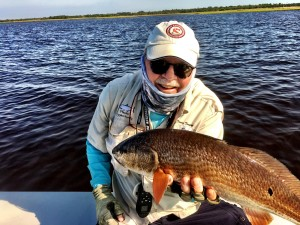 Capt. Tommy Thompson with a topwater redfish.