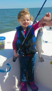 Brooklynn Berger with her first trout!