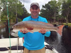 Bruce Abercrombie from Woodstock, Ga. caught this fine upper-slot redfish.