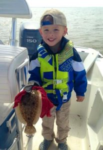 Cason Keen is excited about his flounder.