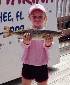 Chloe Truluck and a winning trout in the Fishing for Kids tournament