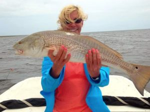 Lisa Marcotte from Canton, Ga with an overslot redfish that had to be released.