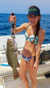 Sabrina Bartelli with a gag grouper that had to be released last month….but not this month.