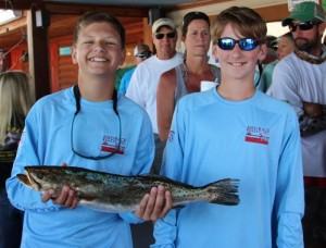 Taylor Carr and Cannon Simmons with the third place trout in the Warriors event.