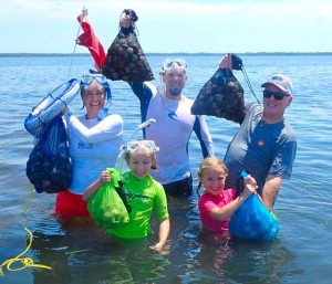 The Riddle family hit the water on opening day and filled their bags with scallops.