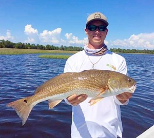 Garrett McKinney with a fine redfish.